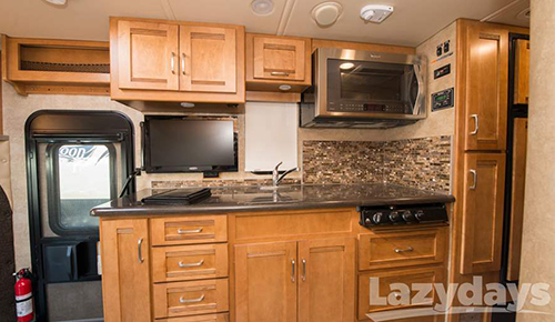 This is a photo of the 2015 Winnebago Aspect kitchen.