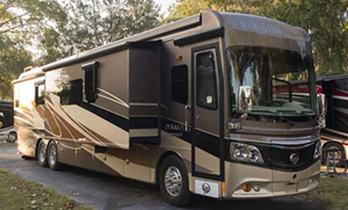 The exterior of the 2015 Monaco Dynasty Class A diesel motorhome offers many comforts for the driver while traveling.