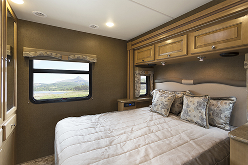 The Class A diesel Thor Windsport features a beautiful master bedroom.