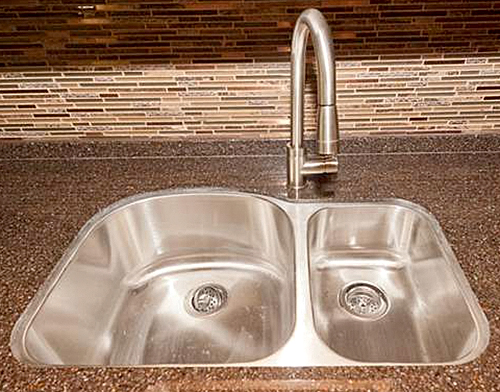 Dual kitchen sinks come standard inside the diesel motorhome American Allegiance