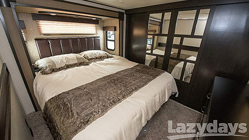The 2016 Grand Design Toy Hauler provides comfort with master suite options for a king or queen bed.