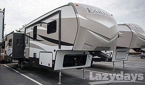 The exterior of the Keystone Laredo Fifth Wheel offers many luxury touches for your traveling convenience.