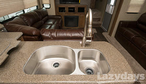 The solid surface countertops inside the 2015 Keystone Laredo Fifth Wheel is one of the many luxury options offered in the RV.