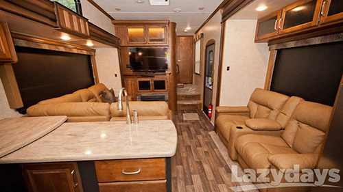 The spacious interior of the 2016 Keystone RV Raptor Toy Hauler is designed to accommodate many friends and family.