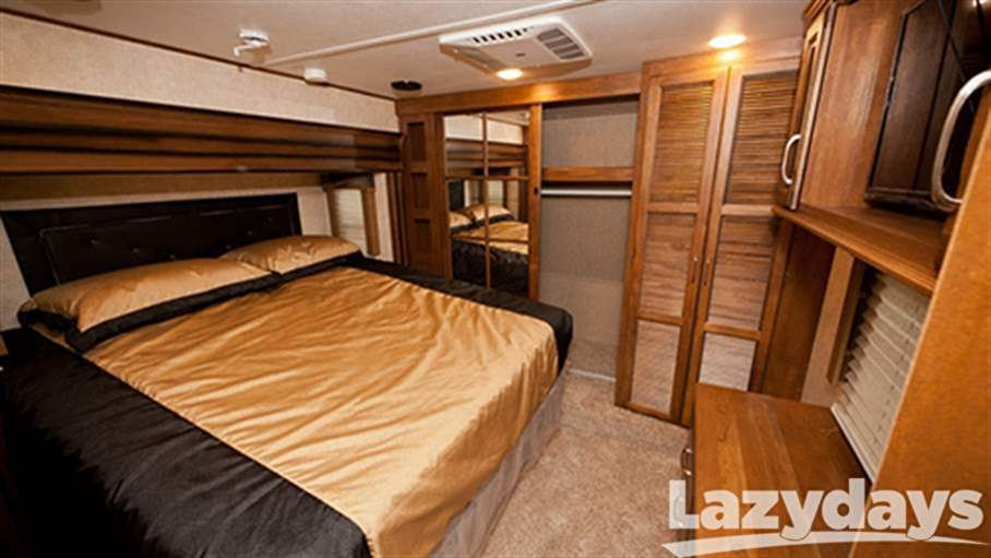 A master bedrooom is included on all the floorplans of the 2016 Keystone RV Raptor Toy Hauler models.