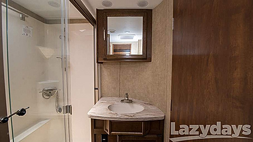 The quadruple slides of the 2016 DRV Mobile Suite 38 RSSA floorplan also offers plenty of storage in the bathroom for travelers.