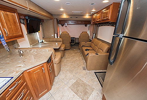 A stylish enterior makes entertaining friends and family enjoyable in the 2016 Forest River Legacy luxury motorhome.